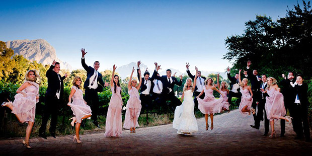 Wedding Party leaping into the air