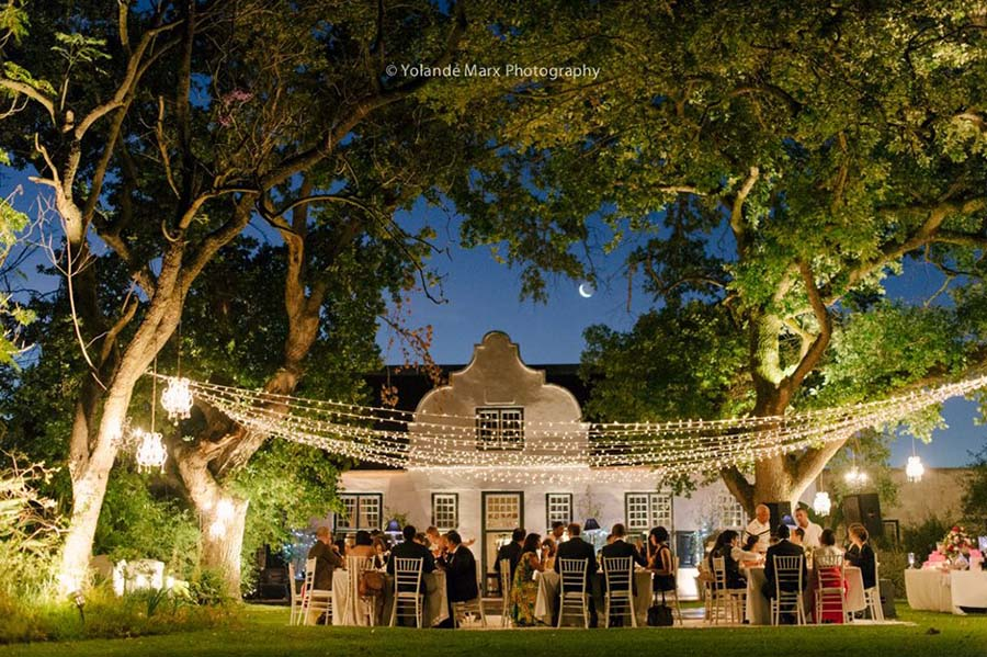 Wedding reception under fairy lights at Hawksmoor House