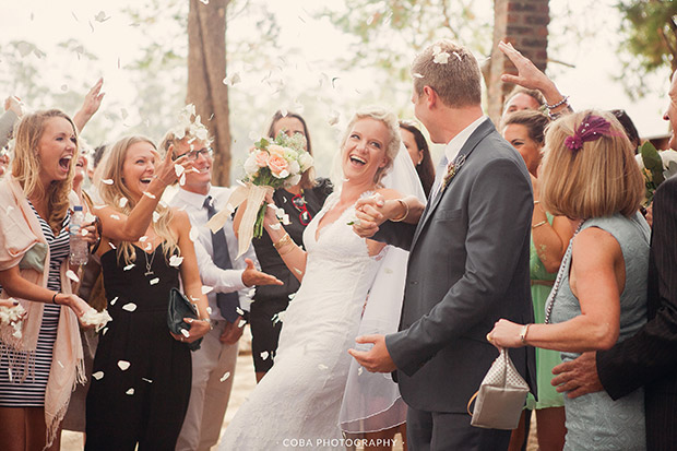 Bride and Groom are showered with Confetti