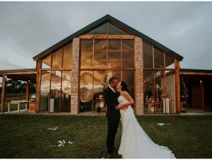Couple Photograph in front of Glasshouse Wedding Venue