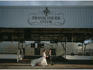 Franschhoek Cellar Wedding Venue Couple Walk past the Warehouse